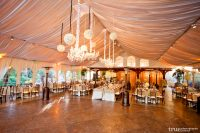 wedding reception black and white chandeliers and pomander balls on the ceiling