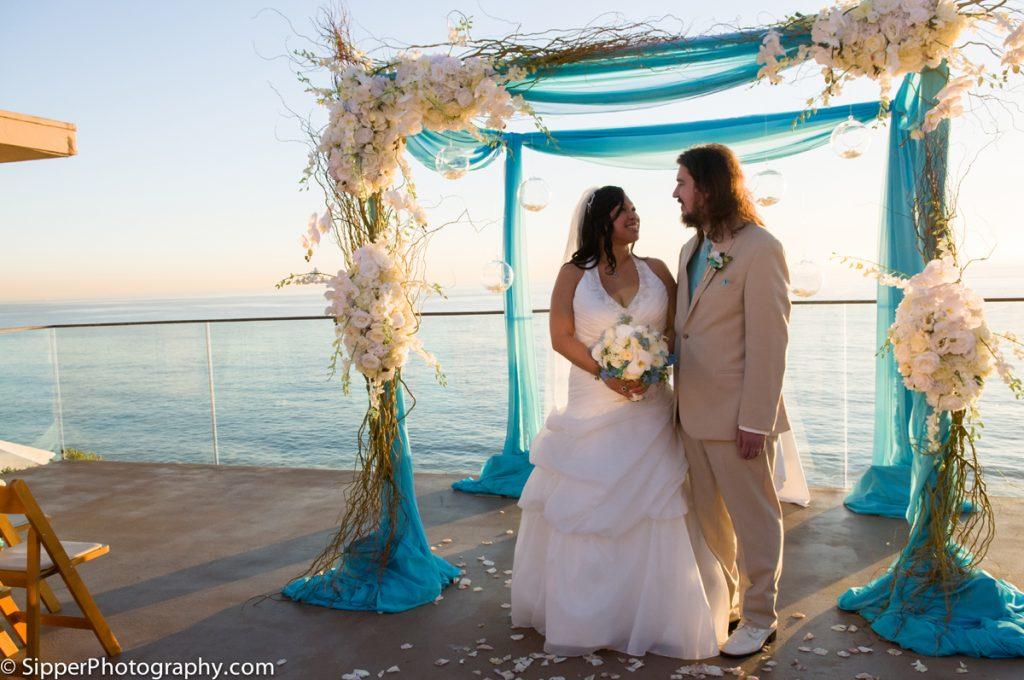 Bride and groom under the wedding arbor