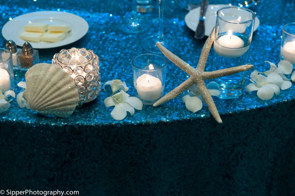 Seashells candles and orchids on the table